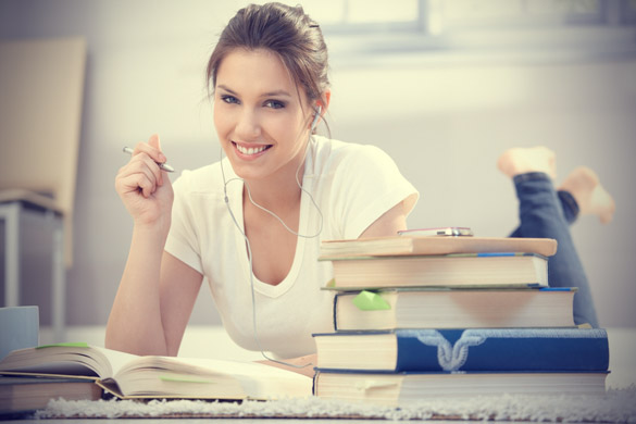 attractive-college-girl-learning-at-home-on-floor-tridindia
